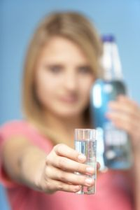 Teenage Girl Holding Glass Of Spirits
